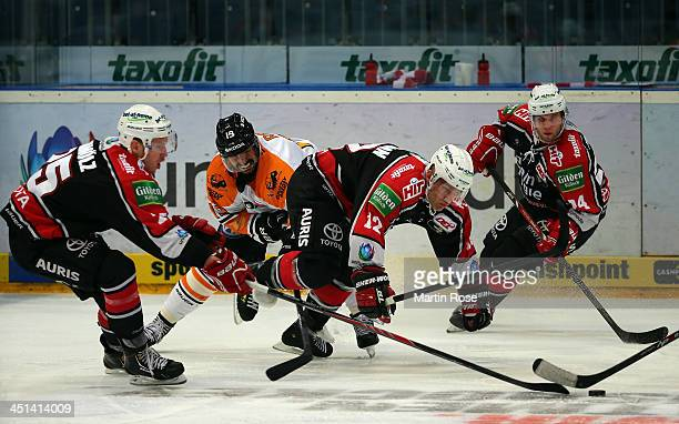Mirko Luedemann of Koeln and Marco Rosa of Wolfsburg battle for the puck during the DEL match between Koelner Haie and Grizzly Adams Wolfsburg at...