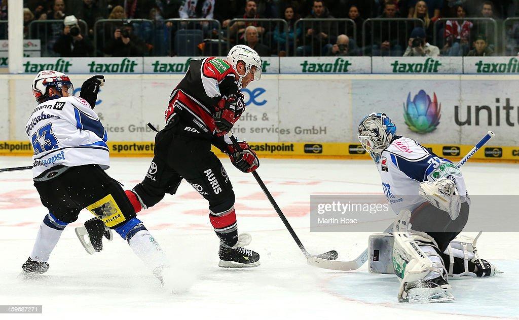Mirko Luedemann of Koeln faisl to score over Dimitri Paetzold goaltender of Schwenningen during the DEL match between Koelner Haie and Schwenninger...
