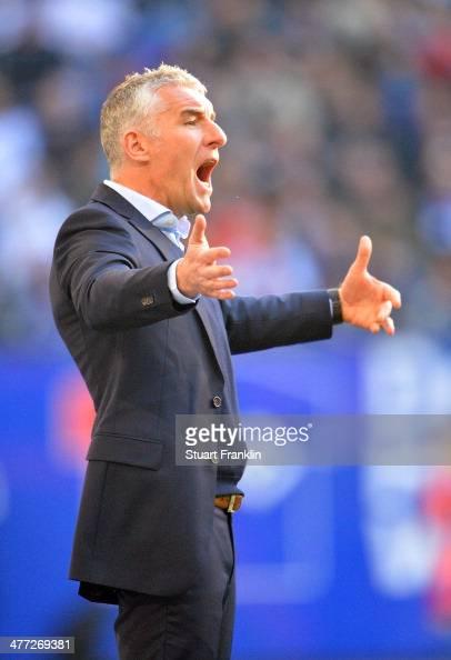 Mirko Slomka head coach of Hamburg gestures during the Bundesliga match between Hamburger SV and Eintracht Frankfurt at Imtech Arena on March 8 2014...