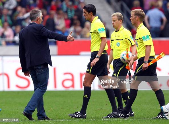 Mirko Slomka head coach of Hannover argues with referee Deniz Aytekin after the Bundesliga match between Hannover 96 and FSV Mainz 05 at AWD Arena on...