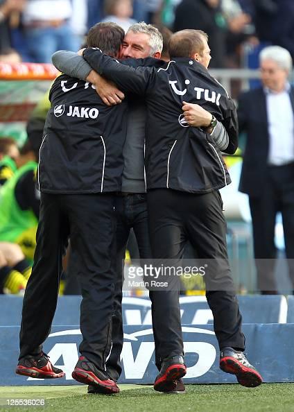 Mirko Slomka head coach of Hannover celebrates after the Bundesliga match between Hannover 96 and Borussia Dortmund at AWD Arena on September 18 2011...
