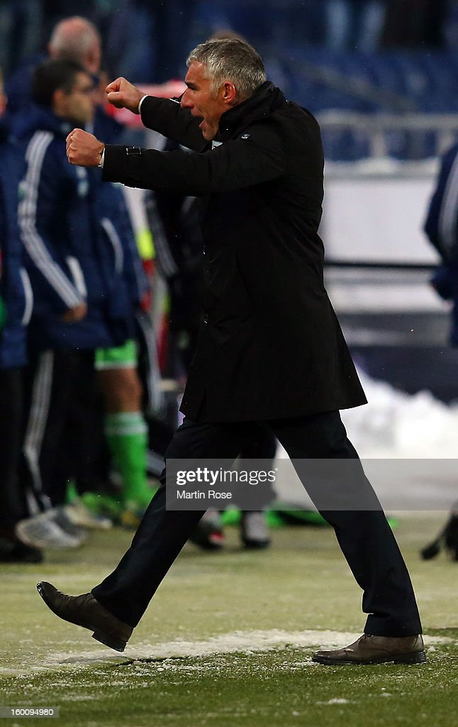 Mirko Slomka, head coach of Hannover celebrates after the Bundesliga match between Hannover 96 and VfL Wolfsburg at AWD Arena on January 26, 2013 in Hannover, Germany.