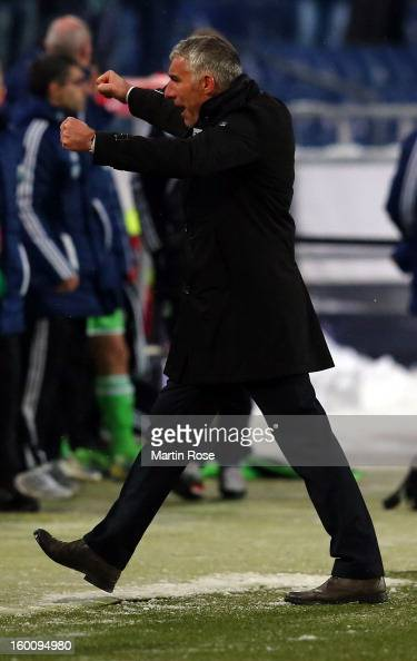 Mirko Slomka head coach of Hannover celebrates after the Bundesliga match between Hannover 96 and VfL Wolfsburg at AWD Arena on January 26 2013 in...