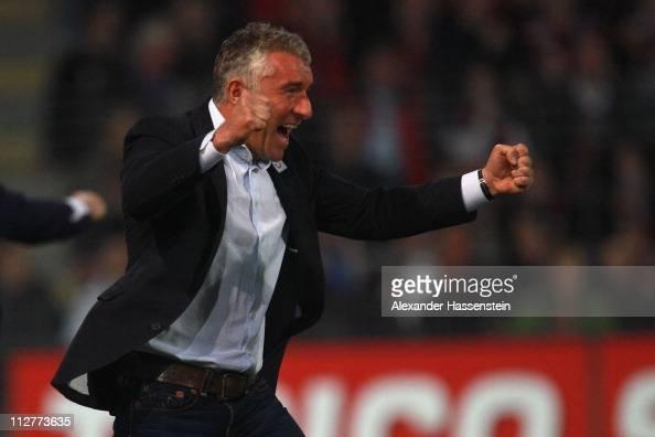 Mirko Slomka head coach of Hannover celebrates his first team goal during the Bundesliga match between SC Freiburg and Hannover 96 at Badenova...