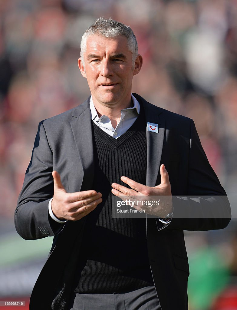 <a gi-track='captionPersonalityLinkClicked' href=/galleries/search?phrase=Mirko+Slomka&family=editorial&specificpeople=874525 ng-click='$event.stopPropagation()'>Mirko Slomka</a>, head coach of Hannover gestures during the Bundesliga match between Hannover 96 v VfB Stuttgart at AWD Arena on April 7, 2013 in Hannover, Germany.