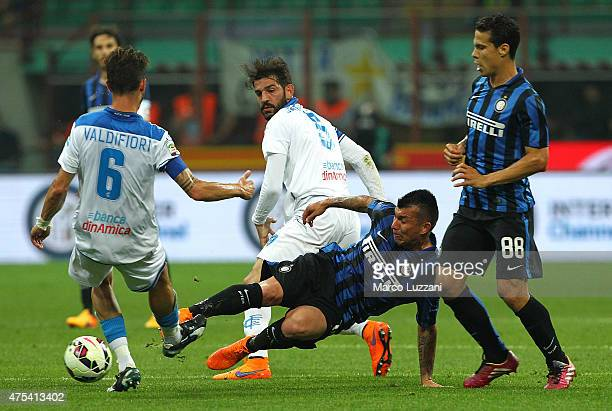 Mirko Valdifior of Empoli FC competes for the ball with Gary Alexis Medel of FC Internazionale Milano during the Serie A match between FC...