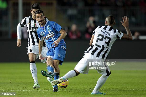 Mirko Valdifiori of Empoli FC battles for the ball with Arturo Vidal of Juventus FC during the Serie A match between Empoli FC and Juventus FC at...