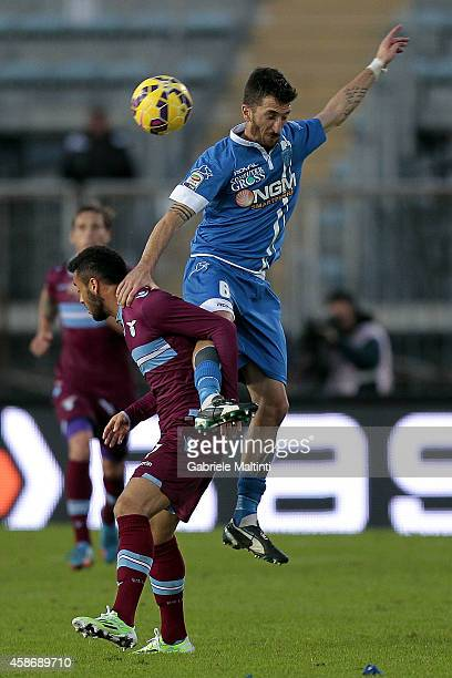 Mirko Valdifiori of Empoli FC battles for the ball with Filip Djordjevic of SS Lazio during the Serie A match between Empoli FC and SS Lazio at...
