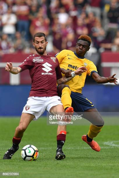 Mirko Valdifiori of Torino FC is challenged by Bioty Moise Kean of Hellas Verona FC during the Serie A match between Torino FC and Hellas Verona FC...