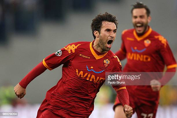 Mirko Vucinic of AS Roma celebrates after scoring the second goal during the Serie A match between SS Lazio and AS Roma at Stadio Olimpico on April...