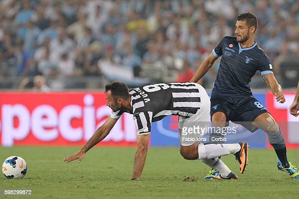 Mirko Vucinic of FC Juventus and Antonio Candreva of SS Lazio compete for the ball during the TIM Supercup match between SS Lazio and FC Juventus at...