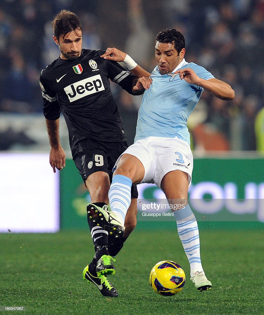 <a gi-track='captionPersonalityLinkClicked' href=/galleries/search?phrase=Mirko+Vucinic&family=editorial&specificpeople=860475 ng-click='$event.stopPropagation()'>Mirko Vucinic</a> of Juventus and Andrè Dias of Lazio in action during the TIM cup match between S.S. Lazio and Juventus FC at Stadio Olimpico on January 29, 2013 in Rome, Italy.