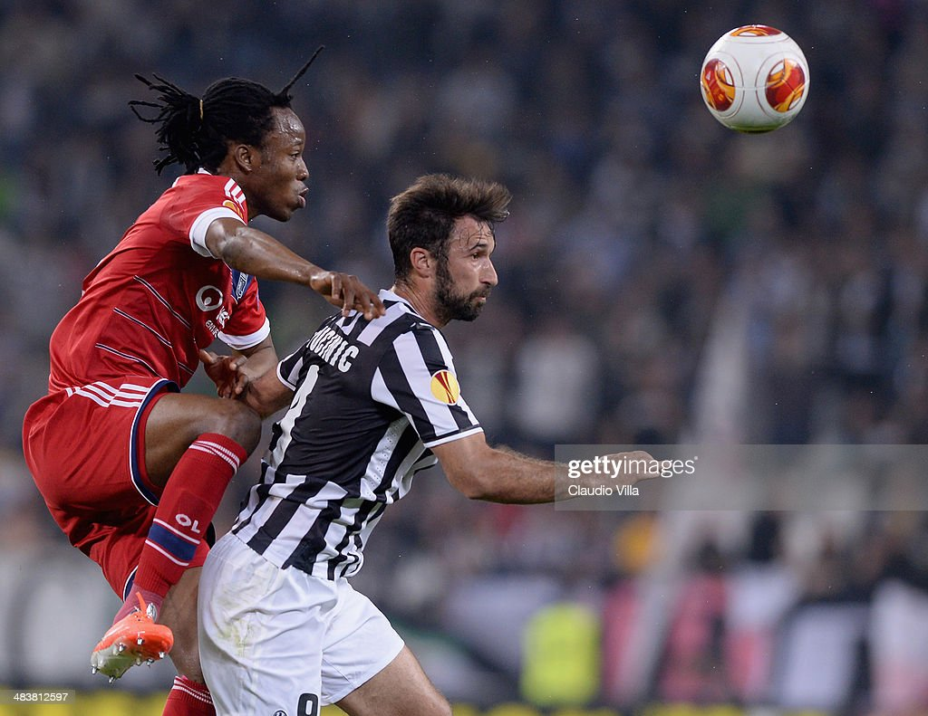 Mirko Vucinic of Juventus and Bakary Kone of Lyon (L) compete for the ball during the UEFA Europa League quarter final match between Juventus and Olympique Lyonnais at Juventus Arena on April 10, 2014 in Turin, Italy.