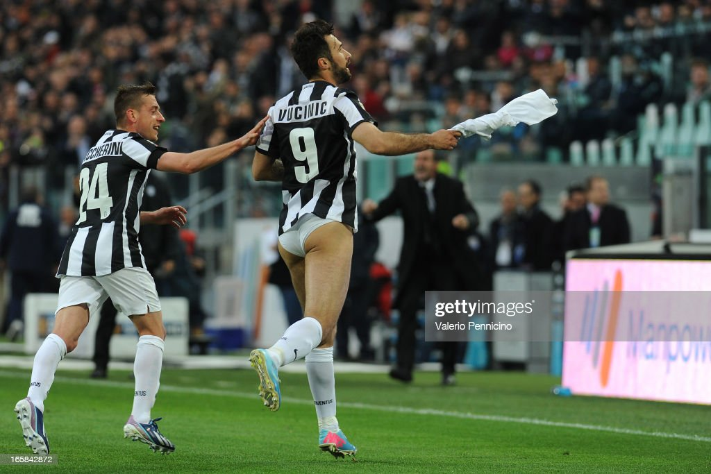 <a gi-track='captionPersonalityLinkClicked' href=/galleries/search?phrase=Mirko+Vucinic&family=editorial&specificpeople=860475 ng-click='$event.stopPropagation()'>Mirko Vucinic</a> (R) of Juventus celebrates the opening goal during the Serie A match between Juventus and Pescara at Juventus Arena on April 6, 2013 in Turin, Italy.