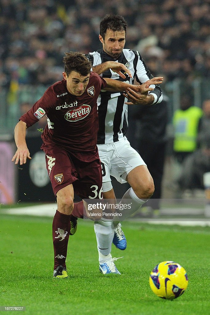 <a gi-track='captionPersonalityLinkClicked' href=/galleries/search?phrase=Mirko+Vucinic&family=editorial&specificpeople=860475 ng-click='$event.stopPropagation()'>Mirko Vucinic</a> (R) of Juventus competes with Matteo Darmian of Torino FC during the Serie A match between Juventus and Torino FC at Juventus Arena on December 1, 2012 in Turin, Italy.