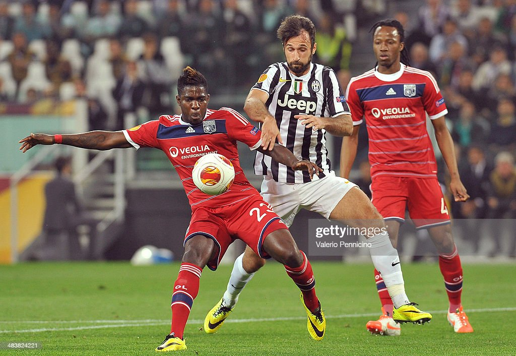 Mirko Vucinic (R) of Juventus competes with Samuel Umtiti of Olympique Lyonnais during the UEFA Europa League quarter final match between Juventus and Olympique Lyonnais at Juventus Arena on April 10, 2014 in Turin, Italy.