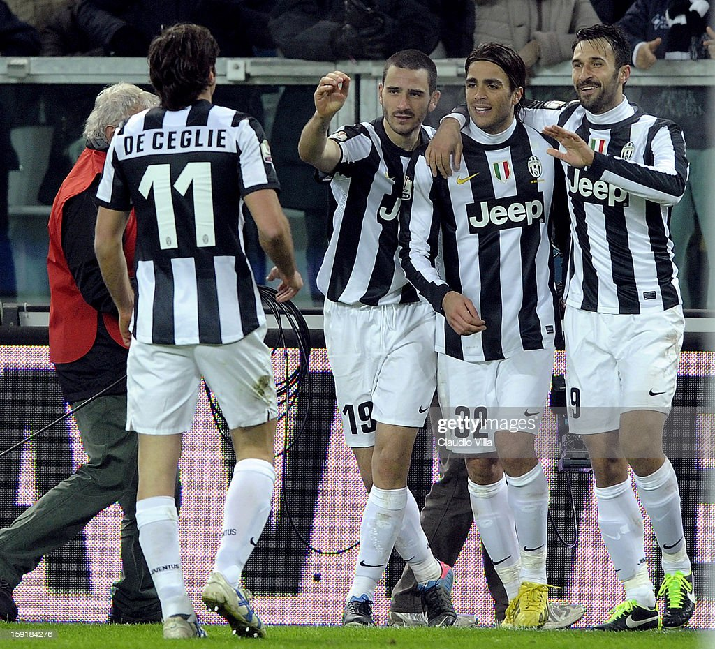 <a gi-track='captionPersonalityLinkClicked' href=/galleries/search?phrase=Mirko+Vucinic&family=editorial&specificpeople=860475 ng-click='$event.stopPropagation()'>Mirko Vucinic</a> of Juventus FC (R) celebrates scoring the second goal during the TIM cup match between Juventus FC and AC Milan at Juventus Arena on January 9, 2013 in Turin, Italy.