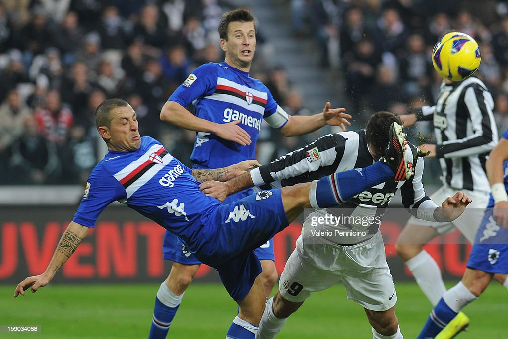 Mirko Vucinic (R) of Juventus FC clsahes with Angelo Palombo of UC Sampdoria during the Serie A match between Juventus FC and UC Sampdoria at Juventus Arena on January 6, 2013 in Turin, Italy.
