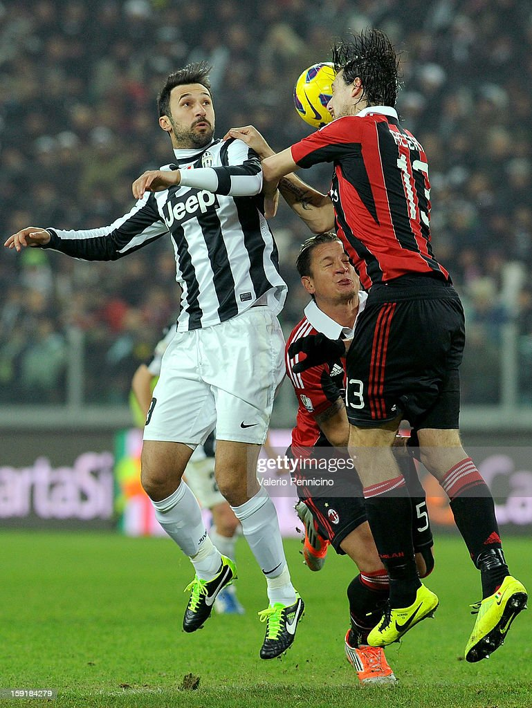 <a gi-track='captionPersonalityLinkClicked' href=/galleries/search?phrase=Mirko+Vucinic&family=editorial&specificpeople=860475 ng-click='$event.stopPropagation()'>Mirko Vucinic</a> (R) of Juventus FC goes up with <a gi-track='captionPersonalityLinkClicked' href=/galleries/search?phrase=Francesco+Acerbi&family=editorial&specificpeople=7122747 ng-click='$event.stopPropagation()'>Francesco Acerbi</a> (R) of AC Milan during the TIM cup match between Juventus FC and AC Milan at Juventus Arena on January 9, 2013 in Turin, Italy.
