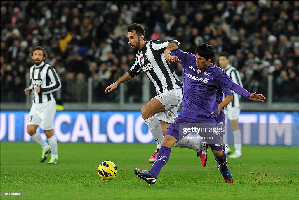 <a gi-track='captionPersonalityLinkClicked' href=/galleries/search?phrase=Mirko+Vucinic&family=editorial&specificpeople=860475 ng-click='$event.stopPropagation()'>Mirko Vucinic</a> (L) of Juventus FC is challenged by <a gi-track='captionPersonalityLinkClicked' href=/galleries/search?phrase=Facundo+Roncaglia&family=editorial&specificpeople=5295709 ng-click='$event.stopPropagation()'>Facundo Roncaglia</a> of ACF Fiorentina during the Serie A match between Juventus FC and ACF Fiorentina at Juventus Arena on February 9, 2013 in Turin, Italy.