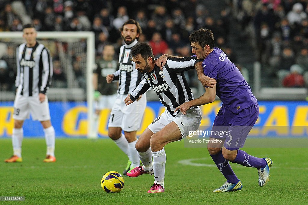 Mirko Vucinic (L) of Juventus FC is challenged by Gonzalo Rodriguez of ACF Fiorentina during the Serie A match between Juventus FC and ACF Fiorentina at Juventus Arena on February 9, 2013 in Turin, Italy.