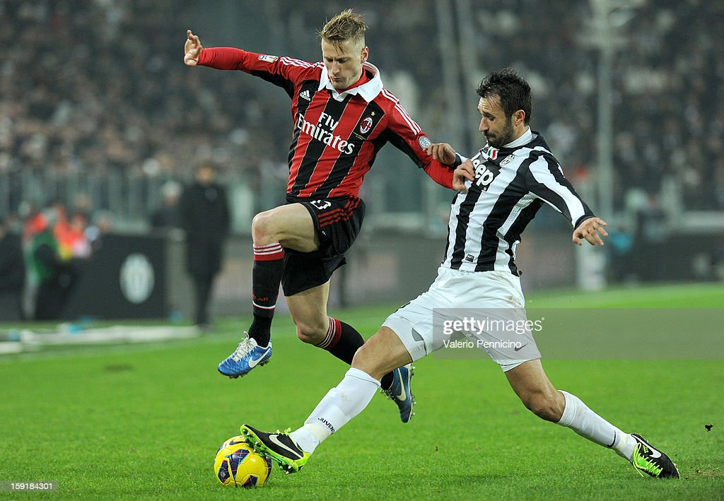 <a gi-track='captionPersonalityLinkClicked' href=/galleries/search?phrase=Mirko+Vucinic&family=editorial&specificpeople=860475 ng-click='$event.stopPropagation()'>Mirko Vucinic</a> (R) of Juventus FC tackles <a gi-track='captionPersonalityLinkClicked' href=/galleries/search?phrase=Ignazio+Abate&family=editorial&specificpeople=4530178 ng-click='$event.stopPropagation()'>Ignazio Abate</a> of AC Milan during the TIM cup match between Juventus FC and AC Milan at Juventus Arena on January 9, 2013 in Turin, Italy.