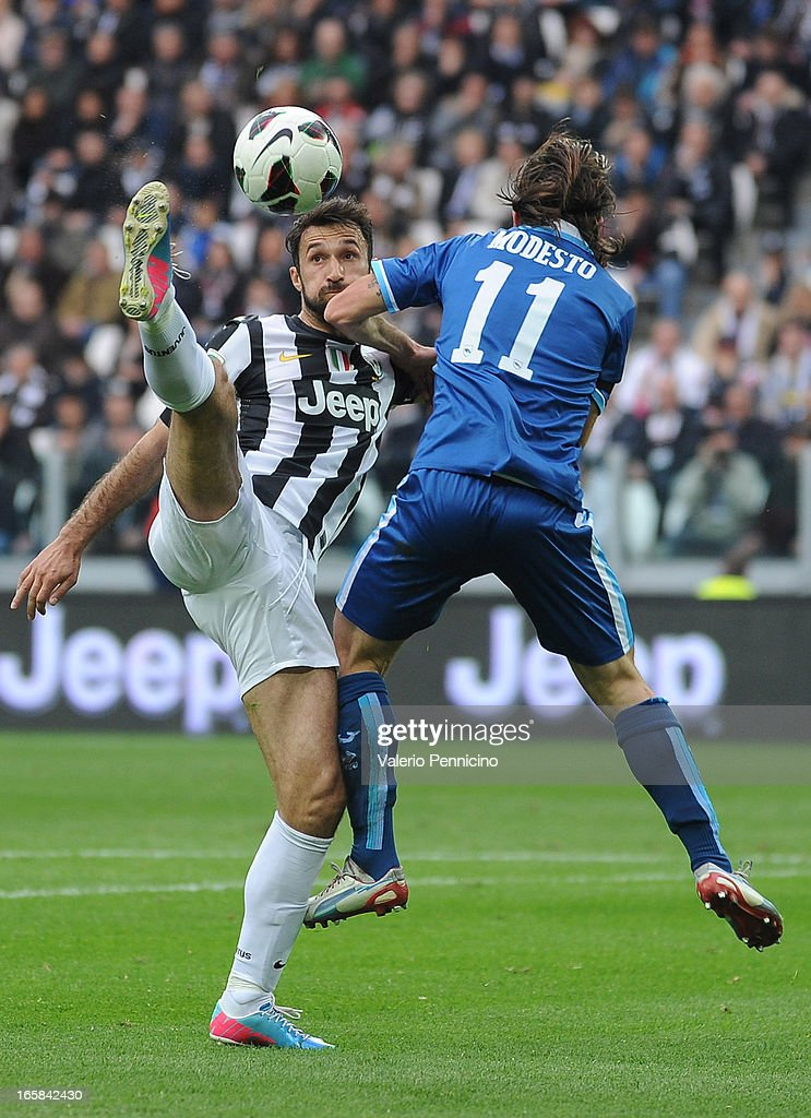<a gi-track='captionPersonalityLinkClicked' href=/galleries/search?phrase=Mirko+Vucinic&family=editorial&specificpeople=860475 ng-click='$event.stopPropagation()'>Mirko Vucinic</a> (L) of Juventus in action against Francesco Modesto of Pescara during the Serie A match between Juventus and Pescara at Juventus Arena on April 6, 2013 in Turin, Italy.