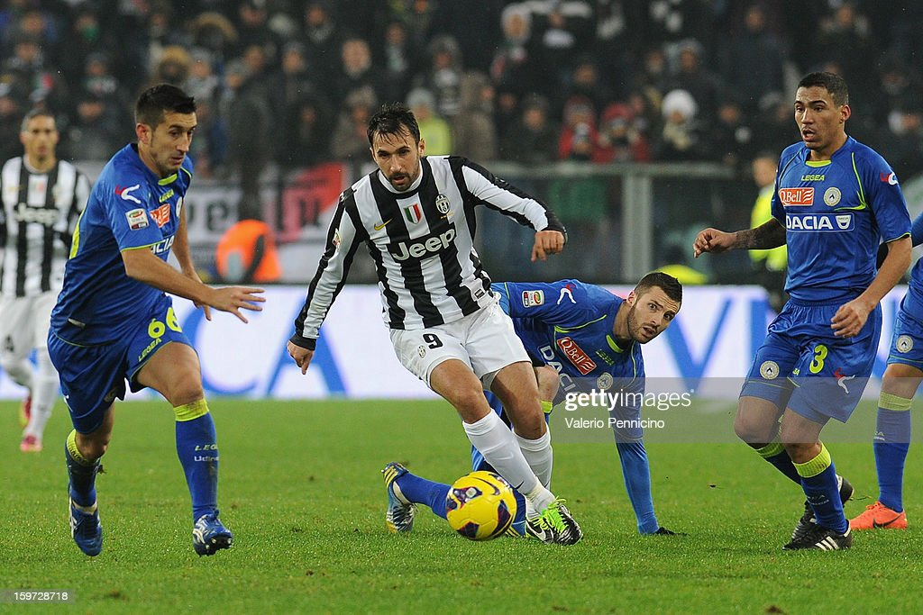 Mirko Vucinic (C) of Juventus in action during the Serie A match between Juventus and Udinese Calcio at Juventus Arena on January 19, 2013 in Turin, Italy.