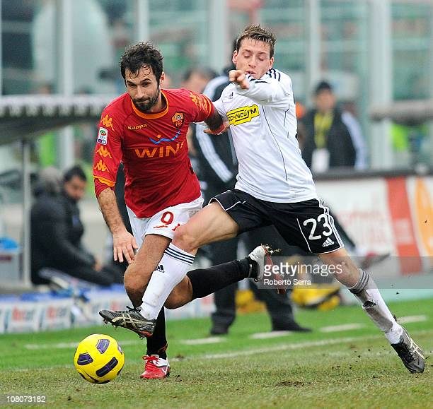 Mirko Vucinic of Roma competes with Emanuele Giaccherini of Cesena during the Serie A match between Cesena and Roma at Dino Manuzzi Stadium on...