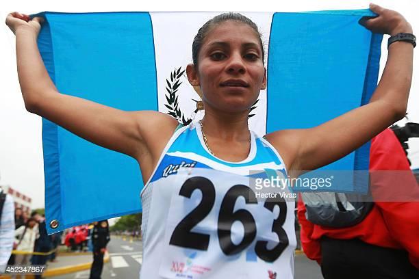 Mirna Ortiz of Guatemala wins the gold medal in women's 20k race walk event as part of the XVII Bolivarian Games Trujillo 2013 at Juan Pablo Street...