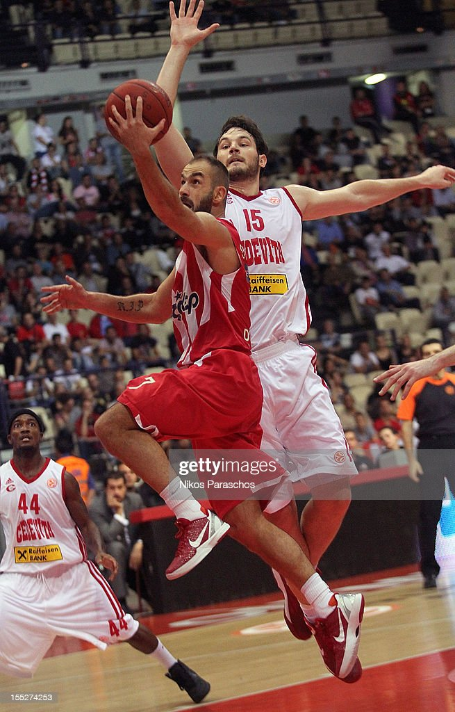 Miro Bilan, #15 of Cedevita Zagreb competes with <a gi-track='captionPersonalityLinkClicked' href=/galleries/search?phrase=Vassilis+Spanoulis&family=editorial&specificpeople=704857 ng-click='$event.stopPropagation()'>Vassilis Spanoulis</a>, #7 of Olympiacos Piraeus during the 2012-2013 Turkish Airlines Euroleague Regular Season Game Day 4 between Olympiacos Piraeus v Cedevita Zagreb at Peace and Friendship Stadium on November 2, 2012 in Athens, Greece.
