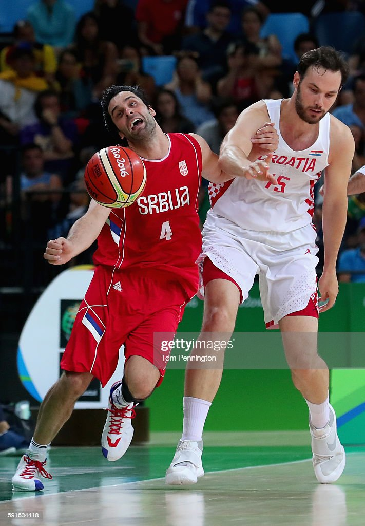 Miro Bilan #15 of Croatia fouls Milos Teodosic #4 of Serbia during the Men's Basketball Quarterfinal game at Carioca Arena 1 on Day 12 of the Rio 2016 Olympic Games on August 17, 2016 in Rio de Janeiro, Brazil.