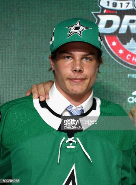 Miro Heiskanen third overall pick of the Dallas Stars poses for a photo onstage during Round One of the 2017 NHL Draft at United Center on June 23...