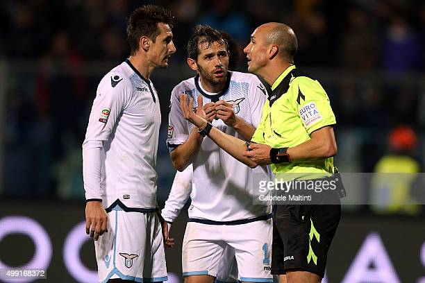 Mirolasv Klose and Senad Lulic of SS Lazio protest during the Serie A match between Empoli FC and SS Lazio at Stadio Carlo Castellani on November 29...