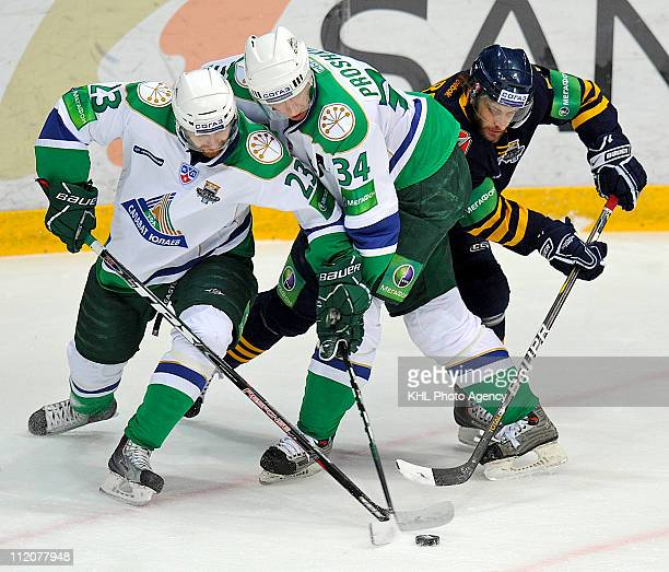 Miroslav Blatak of the Salavat Yulaev Ufa Vitaly Proshkin of the Salavat Yulaev Ufa Jan Marek of the Atlant Mytishchi are seen in action during the...