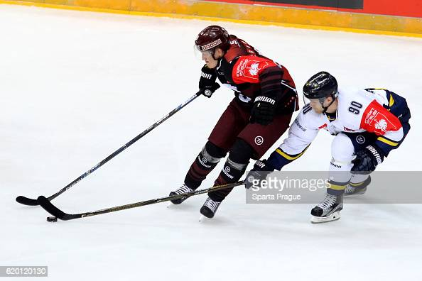 Miroslav Forman of HC Sparta Prague challenges Ted Brithen of Jonkoping during the Champions Hockey League Round of 16 match between Sparta Prague...