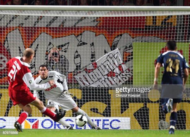 Miroslav Karhan of Mainz scores the second goal by penalty against Faryd Mondragon of Koeln during the DFB Cup second leg match between FSV Mainz 05...