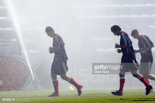 Miroslav Klose and Hamit Altintop of Bayern Muenchen take a refreshment during the FC Bayern Muenchen training session at the Al Nasr training ground...