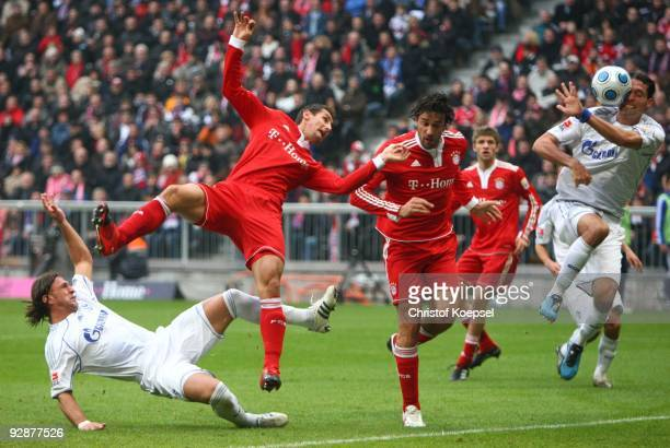 Miroslav Klose and Luca Toni of Bayern Muenchen are challenged by Kevin Kuranyi and Marcelo Bordon of Schalke during the Bundesliga match between FC...