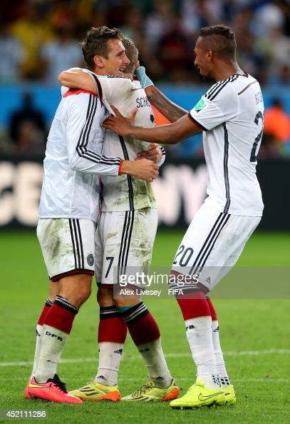 Miroslav Klose Bastian Schweinsteiger and Jerome Boateng of Germany celebrate the win after the 2014 FIFA World Cup Brazil Final match between...