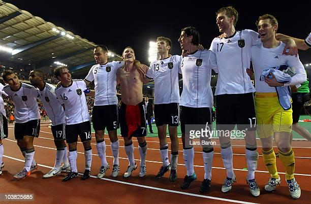 Miroslav Klose Cacau Philipp Lahm Heiko Westermann Thomas Mueller Sami Khedira Per Mertesacker and goalkeeper Manuel Neuer of Germany celebrate after...