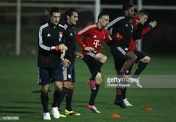 Miroslav Klose Hamit Altintop Franck Ribery Breno and Bastian Schweinsteiger of Bayern stretch during the FC Bayern Muenchen training session at...