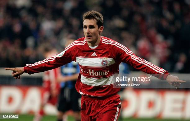 Miroslav Klose of Bayern Munich celebrates after scoring 20 during the DFB Cup Semi Final match between FC Bayern Munich and VfL Wolfsurg at the...