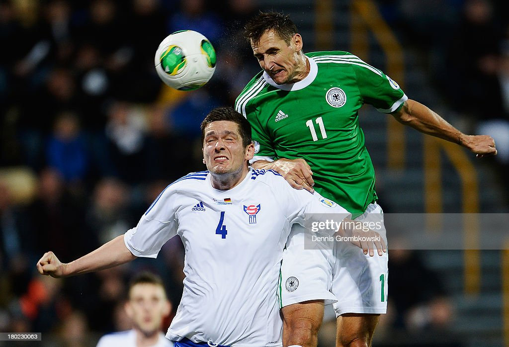 Miroslav Klose of Germany and Atli Gregersen of Faeroe Islands go up for a header during the FIFA 2014 World Cup Qualifier match between Faeroe Islands and Germany on September 10, 2013 in Torshavn, Denmark.