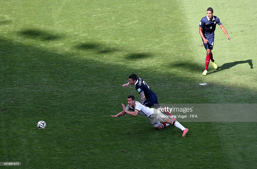 Miroslav Klose of Germany and Mathieu Debuchy of France compete for the ball during the 2014 FIFA World Cup Brazil Quarter Final match between France...