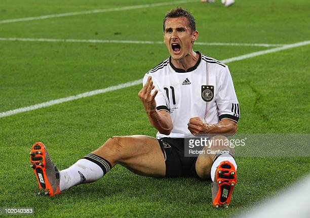 Miroslav Klose of Germany celebrates after he scores his side's second goal during the 2010 FIFA World Cup South Africa Group D match between Germany...