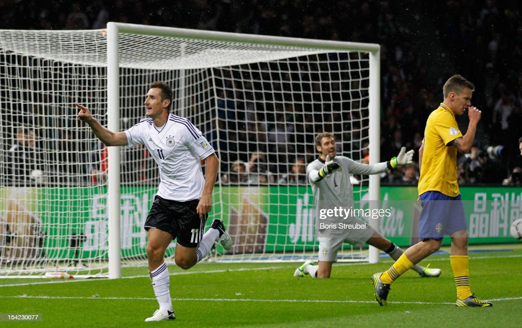 <a gi-track='captionPersonalityLinkClicked' href=/galleries/search?phrase=Miroslav+Klose&family=editorial&specificpeople=206489 ng-click='$event.stopPropagation()'>Miroslav Klose</a> (L) of Germany celebrates after scoring the opening goal as goalkeeper <a gi-track='captionPersonalityLinkClicked' href=/galleries/search?phrase=Andreas+Isaksson&family=editorial&specificpeople=542896 ng-click='$event.stopPropagation()'>Andreas Isaksson</a> (C) of Sweden reacts during the FIFA 2014 World Cup qualifier group C match between German and Sweden at Olympiastadion on October 16, 2012 in Berlin, Germany.