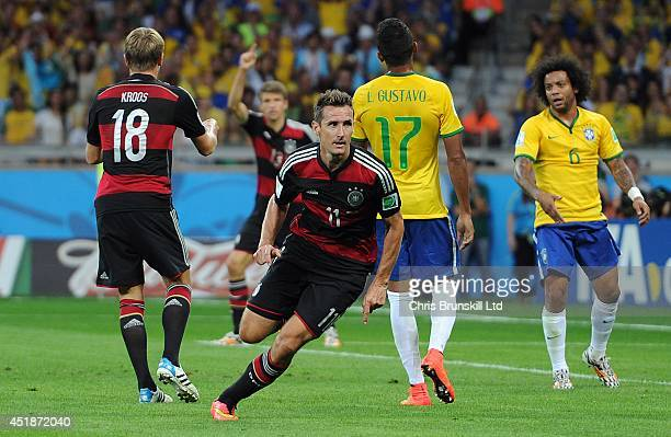 Miroslav Klose of Germany celebrates scoring his side's second goal during the 2014 FIFA World Cup Brazil Semi Final match between Brazil and Germany...