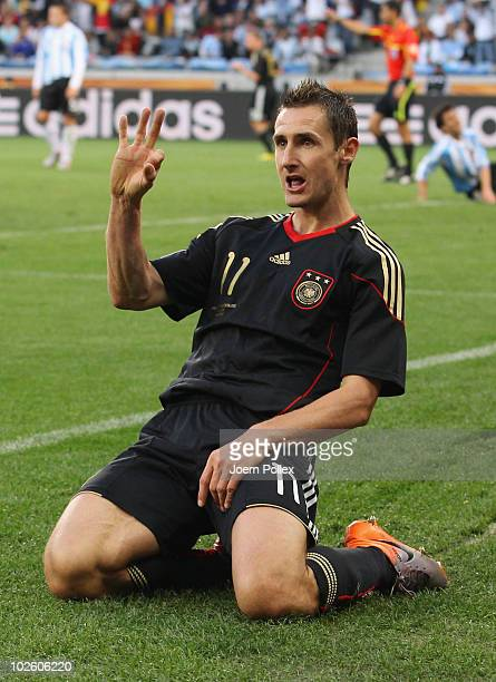 Miroslav Klose of Germany celebrates scoring his team's second goal during the 2010 FIFA World Cup South Africa Quarter Final match between Argentina...