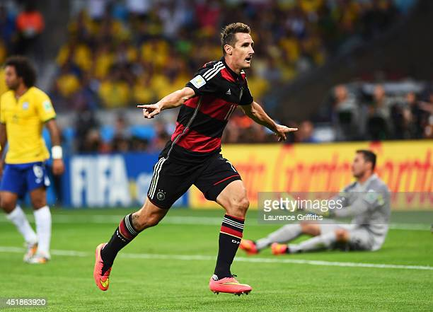 Miroslav Klose of Germany celebrates scoring his team's second goal during the 2014 FIFA World Cup Brazil Semi Final match between Brazil and Germany...